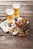 Lager beer glasses and snacks Stock Photos