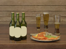 Lager beer in green bottles and glasses of beer froth. Lager beer in green bottles and glasses of beer froth with an exotic dish Stock Image