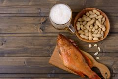 Lager beer mug and fish with peanut Stock Photos