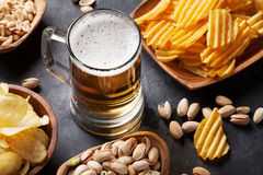 Lager beer mug and snacks Royalty Free Stock Images