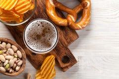 Lager beer mug and snacks Stock Photos