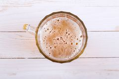 Lager beer mug on white wooden table. stock images