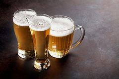 Lager beer mugs Stock Photos