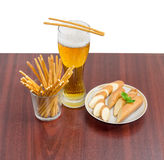 Lager beer, salty hard crispy pretzels, sliced smoked processed Royalty Free Stock Images