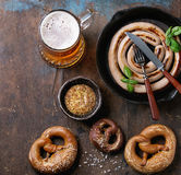 Lager beer with sausage and pretzels Royalty Free Stock Images