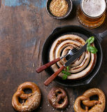 Lager beer with sausage and pretzels Royalty Free Stock Photography