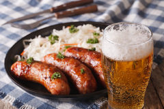 Lager beer and snacks of sausages and sauerkraut Stock Photos