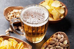 Lager beer and snacks on stone table Stock Photo