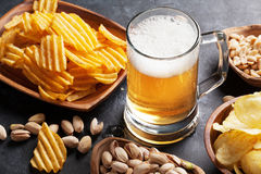 Lager beer and snacks on stone table Royalty Free Stock Photo