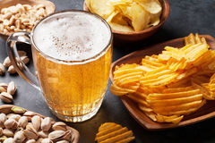 Lager beer and snacks on stone table Stock Photos