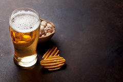 Lager beer and snacks Royalty Free Stock Photos