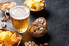 Lager beer and snacks on stone table Stock Photography