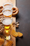 Lager beer and snacks Stock Images