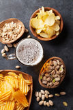 Lager beer and snacks on stone table Royalty Free Stock Photography