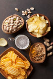 Lager beer and snacks on stone table Stock Image