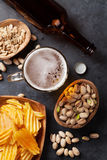 Lager beer and snacks on stone table Royalty Free Stock Image