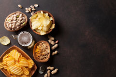 Lager beer and snacks on stone table Stock Images