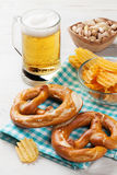 Lager beer and snacks Stock Image