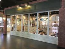 Lager för diversehandel för sko för Commed commeca Arkivbild