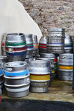 Lager Kegs or Barrels makes one thirsty. These are Beer Kegs or Barrels stacked behind a Pud Stock Images