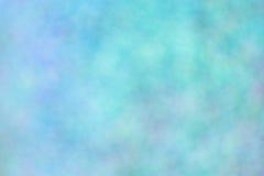 Lagerför suddig bakgrund för blått fotoet Arkivbild