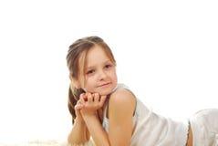 Lagerföra bilden av den lyckliga flickan som isoleras på vit Royaltyfria Foton