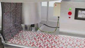 Lagerföra videoen, processen av produktion av preventivpillerar, minnestavlor, röd-vit kapslar arkivfilmer