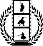 Lagerkrans och film med krigaren Arkivbilder