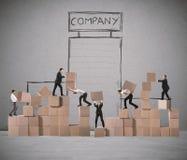 Laget av businesspeople bygger ett nytt företag arkivfoton