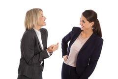 Laget av två isolerade affärskvinnan som firar hennes framgång och Arkivfoton