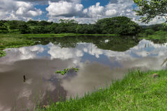 Laggon with clouds and sky reflections Royalty Free Stock Image