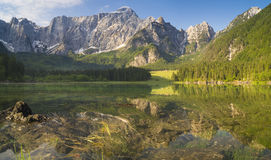 Laghi di fusine-mountain lake in the Italian Alps. The fishing boat,lake Dabie Royalty Free Stock Images