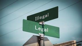 Lagligt kontra olagligt f?r gatatecken arkivbilder
