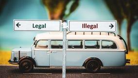 Lagligt kontra olagligt f?r gatatecken arkivfoton