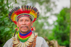 Free LAGO AGRIO, ECUADOR - NOVEMBER 17, 2016: Close Up Of A Siona Shaman In Traditional Dress With A Feather Hat In An Stock Images - 95164974