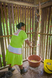 LAGO AGRIO, ECUADOR - NOVEMBER, 17 2016: Woman demonstrates cooking yucca tortillas in an indoors in a Siona village in. The Cuyabeno Wildlife Reserve, Ecuador stock images