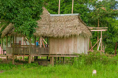 LAGO AGRIO, ECUADOR - NOVEMBER 17, 2016: Wooden house of siona community located inside of the amazon region in Cuyabeno. Cuyabeno National Park, South America Stock Photos