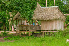 LAGO AGRIO, ECUADOR - NOVEMBER 17, 2016: Wooden house of siona community located inside of the amazon region in Cuyabeno. Cuyabeno National Park, South America Royalty Free Stock Photos