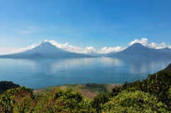 Lago Atitlan along with 2 volcanoes, Panajachel, Guatemala Stock Images