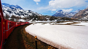 Lago Bianco, Swiss. Bernina Express train passing through ago Bianco (White Lake), Graubunden, Swiss Royalty Free Stock Images