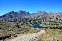 Lago Camporells e picco di Peric in Pyrenees Immagine Stock