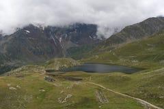 Lago cerca del Gavia de Passo Foto de archivo