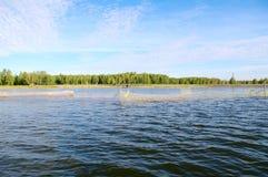 Lago com redes de pesca Imagens de Stock
