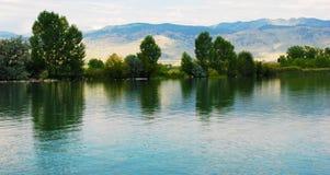 Lago con le riflessioni delicate Fotografia Stock