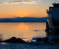 Lago congelado ocaso Fotos de archivo libres de regalías