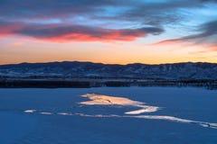 Lago congelado por do sol imagem de stock