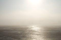 Lago congelato e luce solare Fotografie Stock
