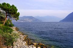 Lake Iseo, seen from its west bank. Lago d`Iseo or Sebino is the fourth largest lake in Lombardy, Italy, fed by the Oglio river. It is in the north of the stock photo