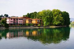 The left bank of Oglio river and a part of Paratico town, seen from the bridge who connect the cities Sarnico and Paratico. Lago d`Iseo or Sebino is the fourth stock image