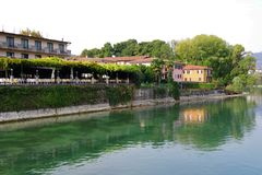 The left bank of Oglio river and a part of Paratico town, seen from the bridge who connect the cities Sarnico and Paratico. Lago d`Iseo or Sebino is the fourth stock images